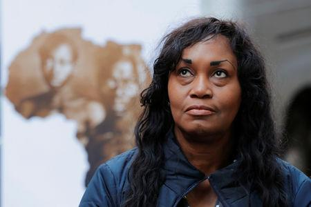 Tamara Lanier listens as her lawyer speaks to the media about a lawsuit accusing Harvard University of the monetization of photographic images of her great-great-great grandfather, an enslaved African man named Renty, and his daughter Delia, outside of the Harvard Club in New York, U.S., March 20, 2019. REUTERS/Lucas Jackson