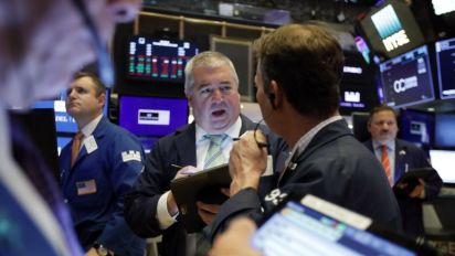 Stocks paring gains after hitting new highs