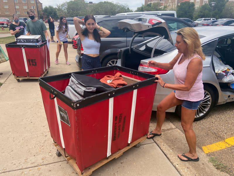 Kaitlyn Abercia is seen moving into her student residence at Gates Hall on the campus of Texas Tech University in Lubbock