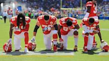 NFL players protesting in response to Trump criticism