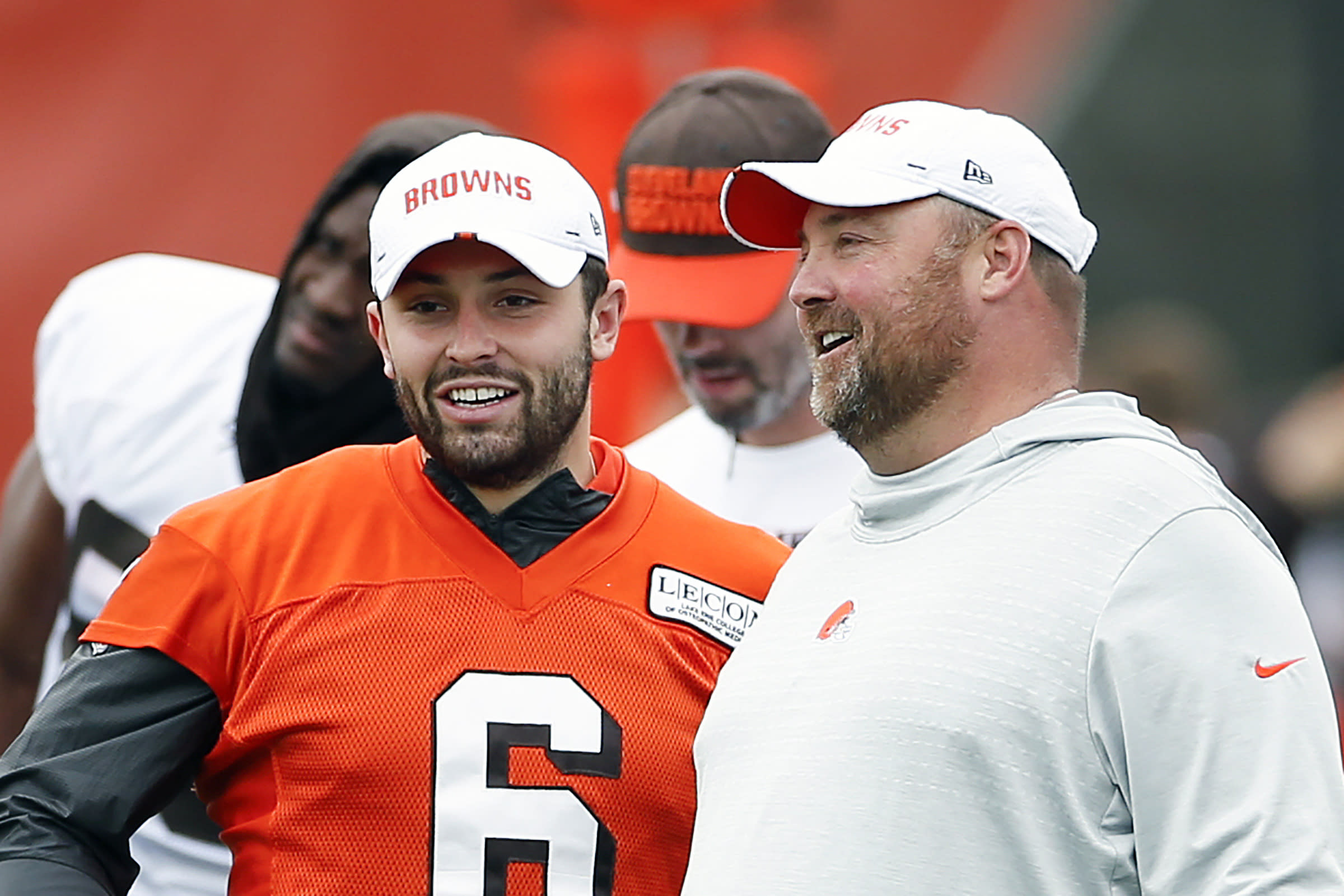 FILE - In this June 4, 2019, file photo, Cleveland Browns quarterback Baker Mayfield (6) talks with head coach Freddie Kitchens at the team's NFL football training facility in Berea, Ohio. Browns coach Freddie Kitchens says he doesnt care if controversial comments by brash quarterback Baker Mayfield put a target on his team. (AP Photo/Ron Schwane, File)