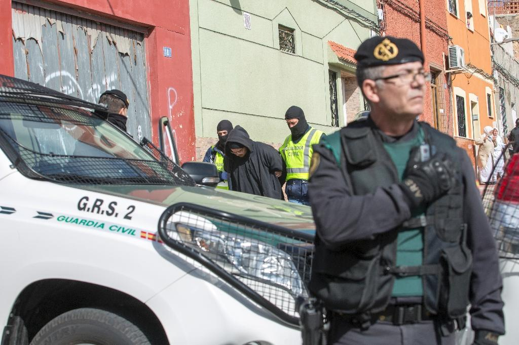 Police arrest on of two suspects in the Spanish enclave Melilla on February 24, 2015. The pair are alleged to be behind the creation and operation of several Internet platforms spreading propaganda (AFP Photo/Angela Rios)