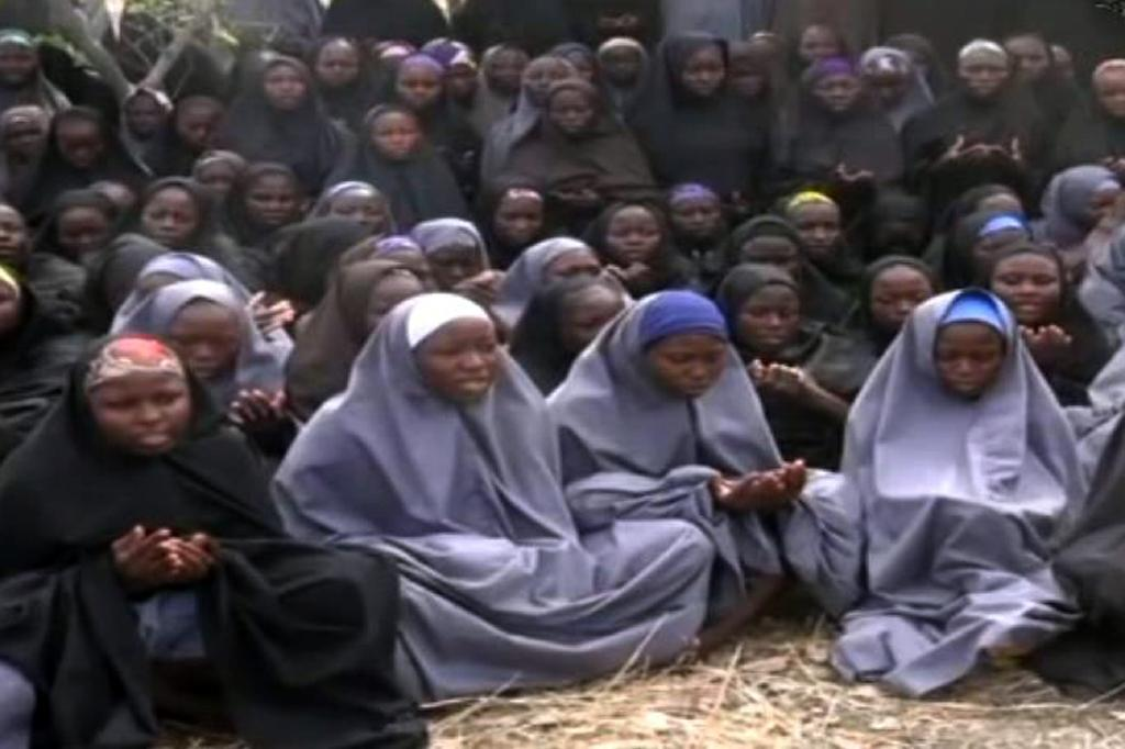 Screengrab taken on May 12, 2014, from a video of Nigerian Islamist extremist group Boko Haram shows girls wearing the full-length hijab and praying in an undisclosed rural location (AFP Photo/)