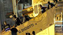 Dozens of migrants disembark from coastguard ship in Italy