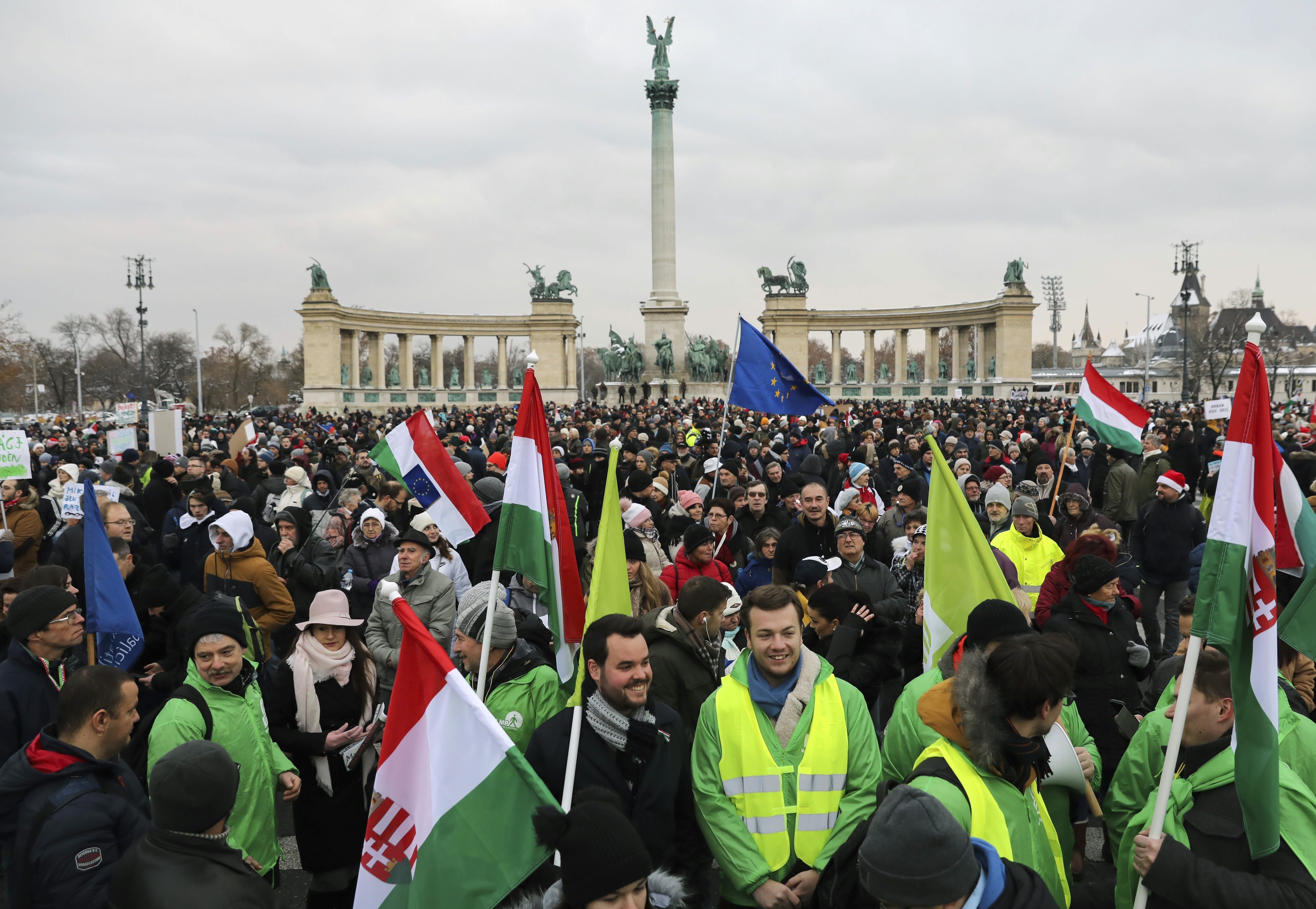 Participants of the anti-government demonstration under the title Merry Christmas, Mr. Prime Minister gather in Heroes' Square in Budapest, Hungary, Sunday, Dec. 16, 2018. (Balazs Mohai/MTI via AP)