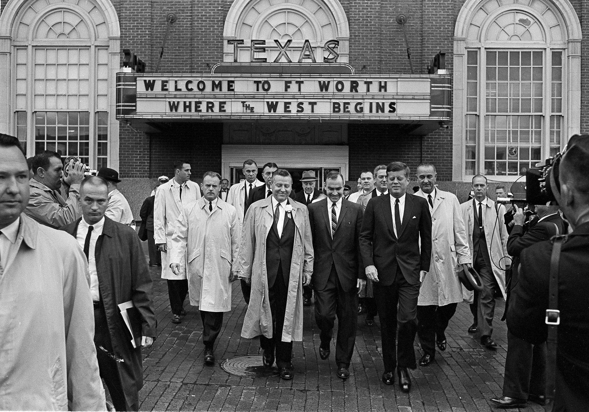 President John F. Kennedy, front, right, exits the Hotel Texas in Fort Worth, at 8:45 a.m., Nov. 22, 1963. He is on his way to greet crowds and make a speech. At right holding hat and wearing raincoat is Vice President Lyndon B. Johnson. (Photo: AP)