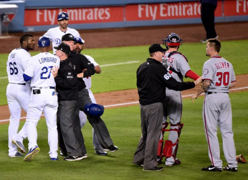 Yasiel Puig and Koda Glover were separated before anything could happen. (Getty Images)