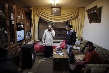 The family of Muhammad Musallam, an Israeli Arab held by Islamic State in Syria as an alleged spy, watch television reports about him in their East Jerusalem home