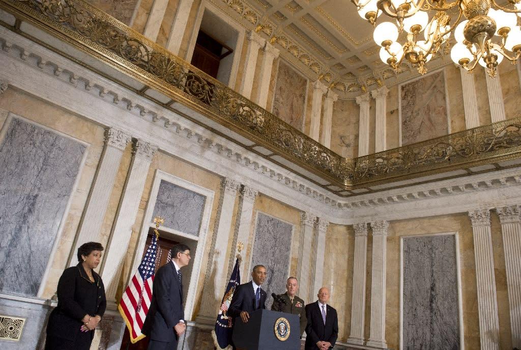 US President Barack Obama speaks alongside his national security team at the Department of Treasury on June 14, 2016 (AFP Photo/Saul Loeb)
