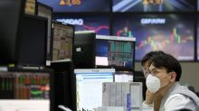Global stocks mostly slip as virus weighs on companies