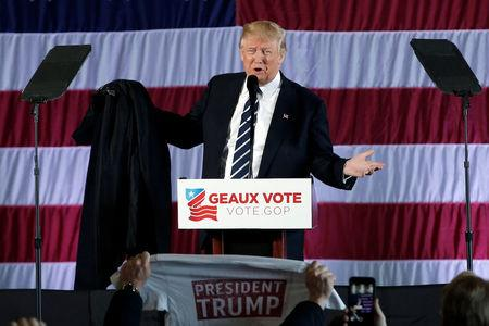 "U.S. President-elect Donald Trump removes his coat as he speaks during a ""Thank You USA"" tour rally in Baton Rouge"