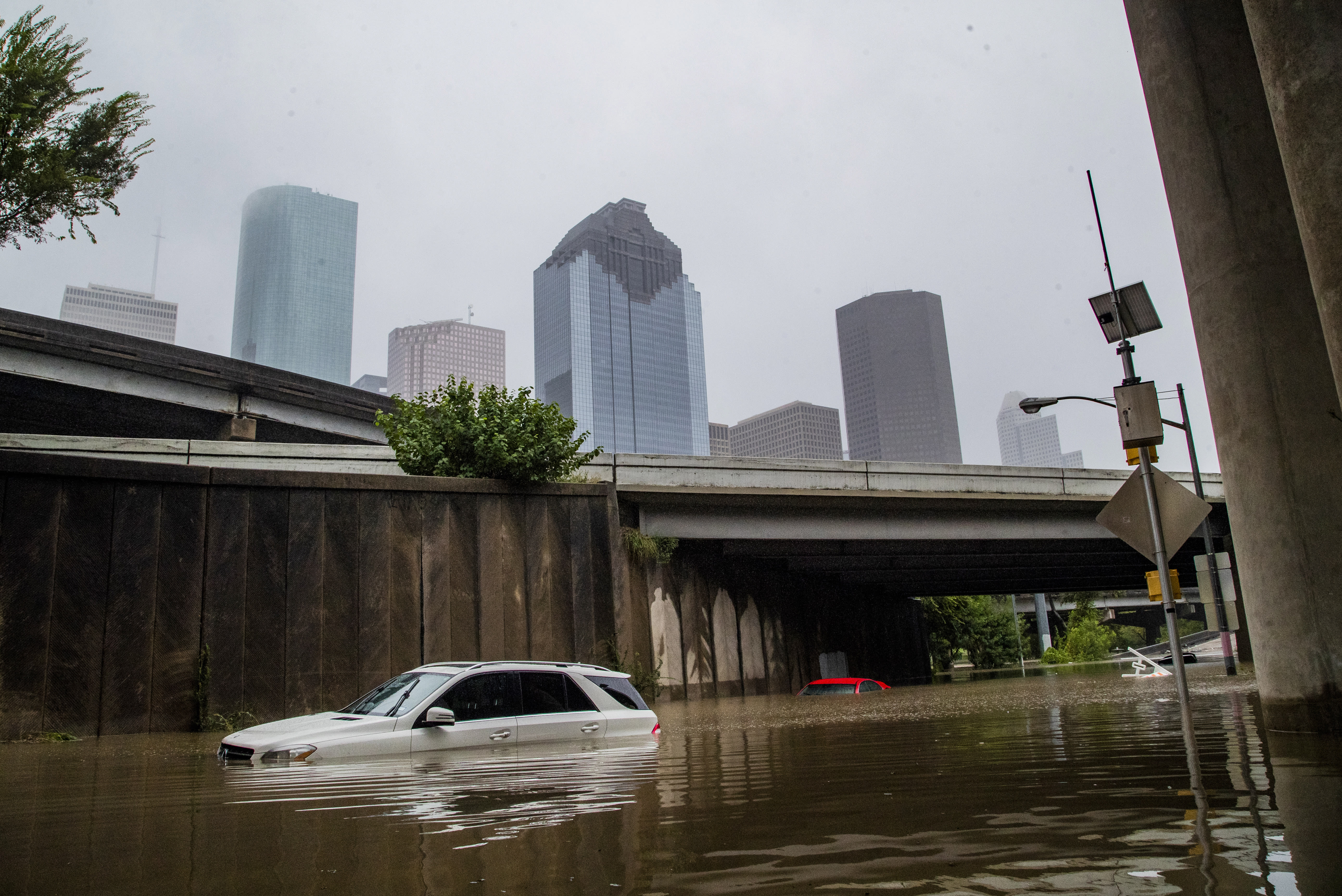 Cars get stranded on high flood waters on Houston Ave. exit from Interstate 45 during Tropical Storm Beta Tuesday, Sept. 22, 2020, in Houston. (Marie D. De Jesus/Houston Chronicle via AP)