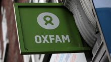 Oxfam gets backing from Theresa May