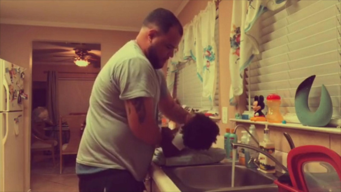 Dad and daughter bond while washing her hair