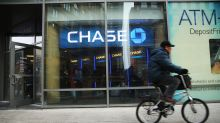Stocks waver, Dow hits new intraday high as investors parse trio of bank earnings
