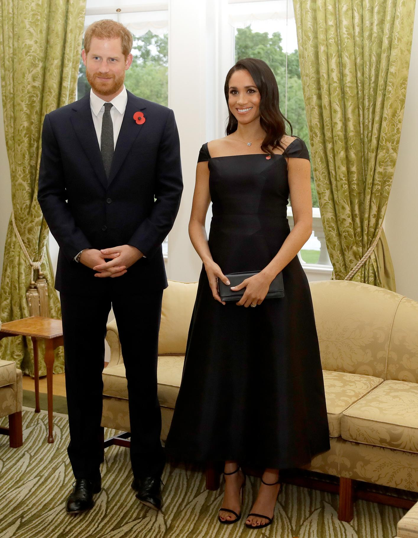 """The Duchess of Sussex attended a reception at Government House on October 28, 2018 in Wellington, New Zealand, alongside Prince Harry in a black Gabriela Hearst dress and <a href=""""https://www.google.com/search?q=stuart+weitzman&oq=stuart+we&aqs=chrome.0.0l2j69i61j69i57j0l2.2432j0j7&sourceid=chrome&ie=UTF-8"""">Stuart Weitzman</a> heels."""