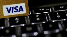 Visa tops profit estimates, raises full-year earnings forecast