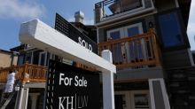 U.S. home sales tumble as prices race to record high
