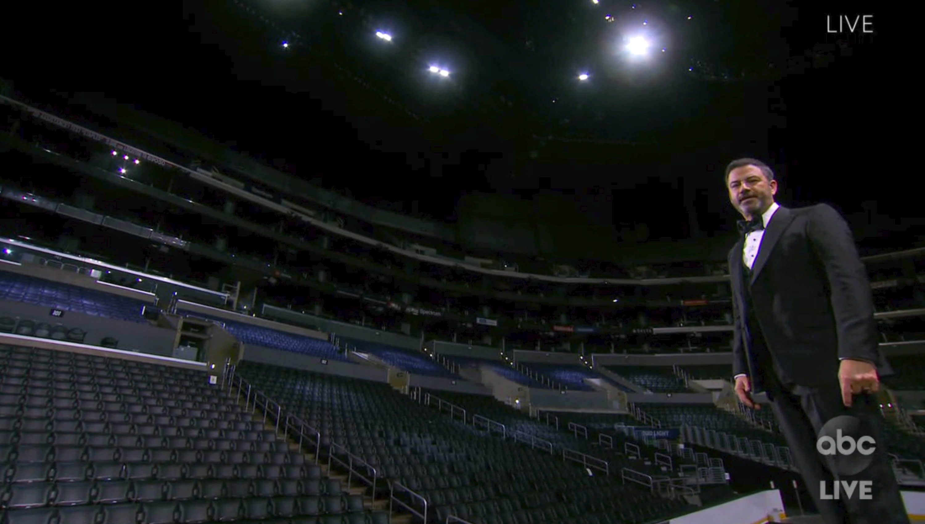 In this video grab captured on Sept. 20, 2020, courtesy of the Academy of Television Arts & Sciences and ABC Entertainment, host Jimmy Kimmel speaks on stage in front of empty seats during the 72nd Emmy Awards broadcast. (The Television Academy and ABC Entertainment via AP)