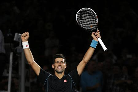 Djokovic reacts after defeating Ferrer in the men's singles final match at the Paris Masters men's singles tennis tournament in Paris