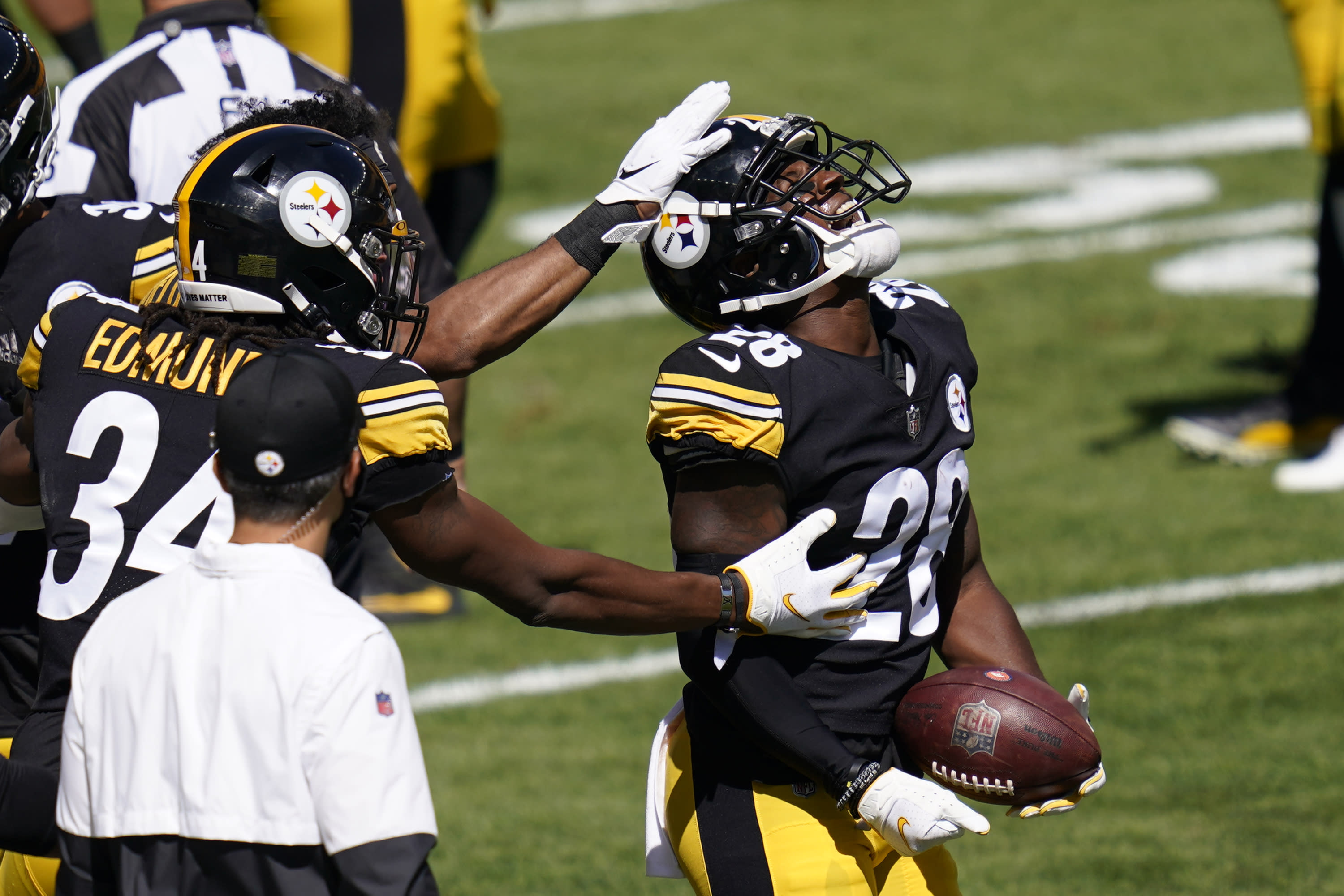 Pittsburgh Steelers cornerback Mike Hilton (28) celebrates after recovering a fumble by Denver Broncos quarterback Drew Lock (3) during the first half of an NFL football game, Sunday, Sept. 20, 2020, in Pittsburgh. (AP Photo/Keith Srakocic)