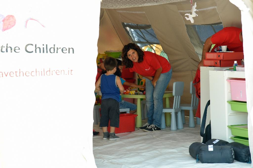 "Save the Children says tent in a camp set up by the Civil Protection agency for quake victims provides ""a safe place, a protected place,"" where children can find ""a bit of peace"" (AFP Photo/Andreas Solaro)"