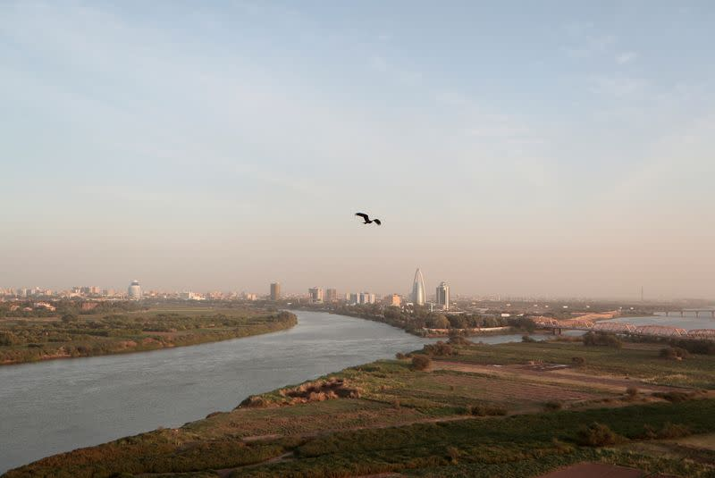 FILE PHOTO: A bird flies over the convergence between the White Nile river and Blue Nile river in Khartoum, Sudan