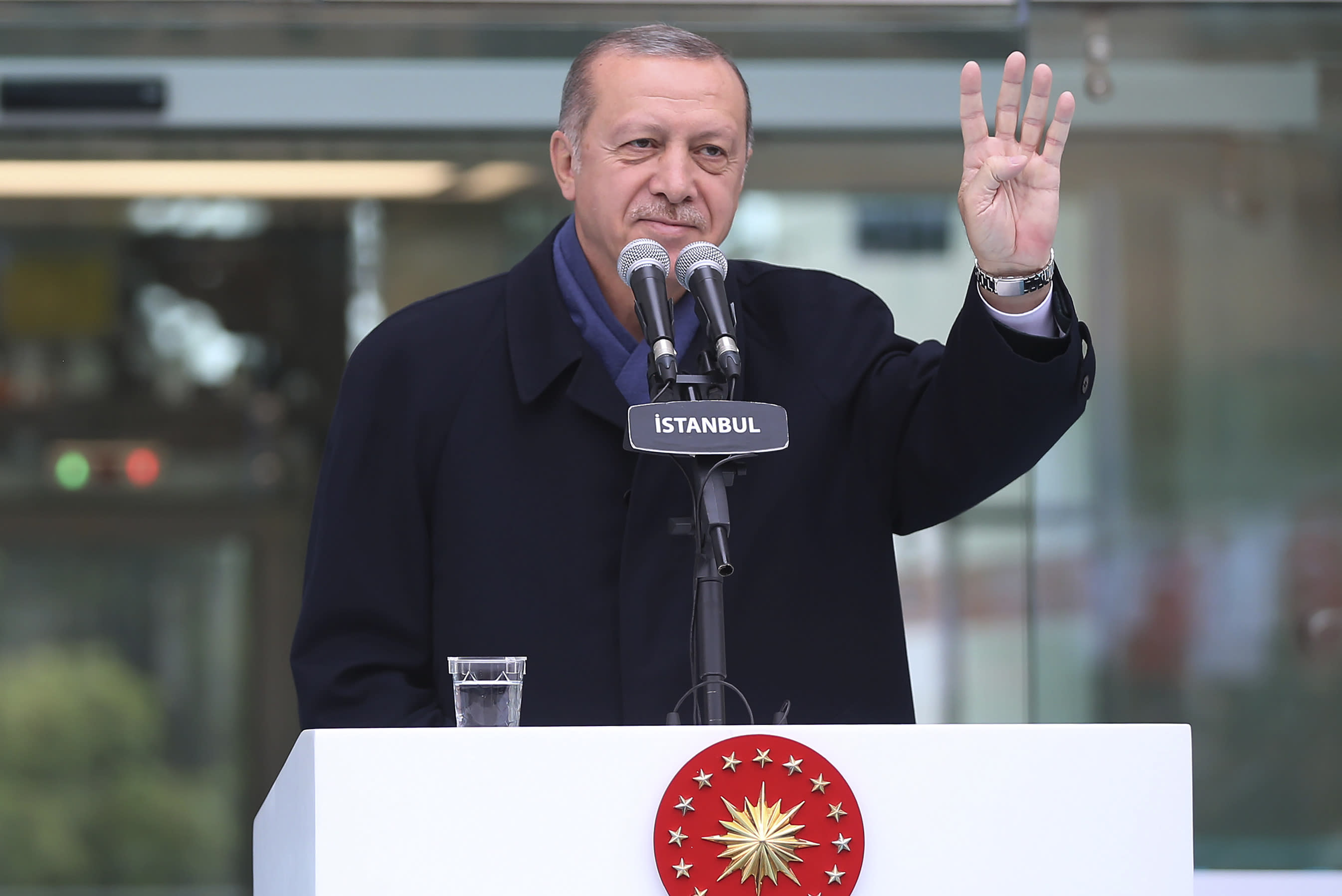 Turkish President Recep Tayyip Erdogan, waves following his speech at an opening ceremony for a new metro station in Istanbul, Sunday, Oct. 21, 2018. Erdogan says he will announce details of the Turkish investigation into the death of Saudi writer Jamal Khashoggi's on Tuesday. (Presidential Press Service via AP, Pool)