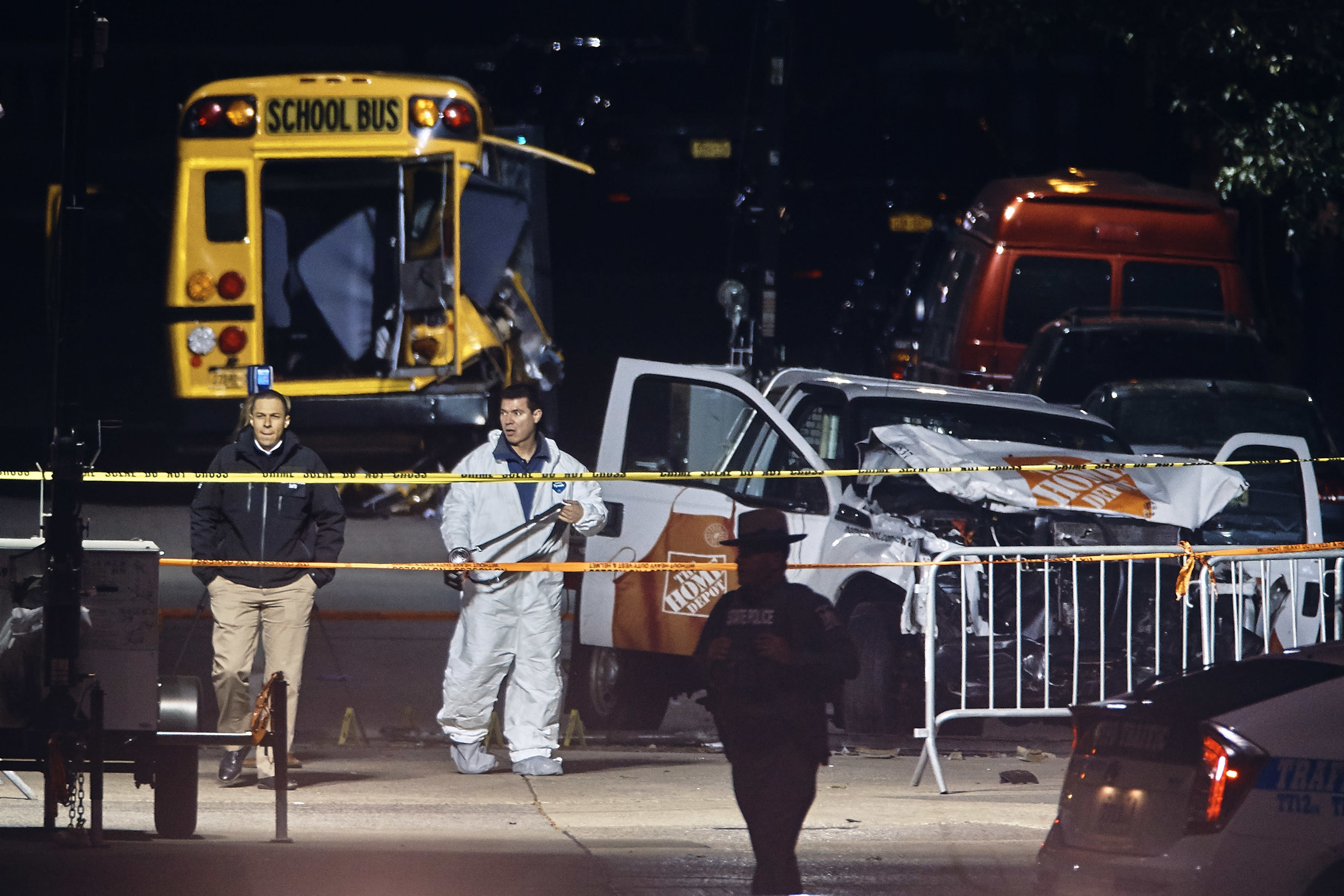 <p>Police work near a damaged Home Depot truck after a motorist drove onto a bike path near the World Trade Center memorial, striking and killing several people, Wednesday, Nov. 1, 2017, in New York. (Photo: Andres Kudacki/AP) </p>