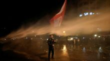 Lebanese security fire water cannons at protesters