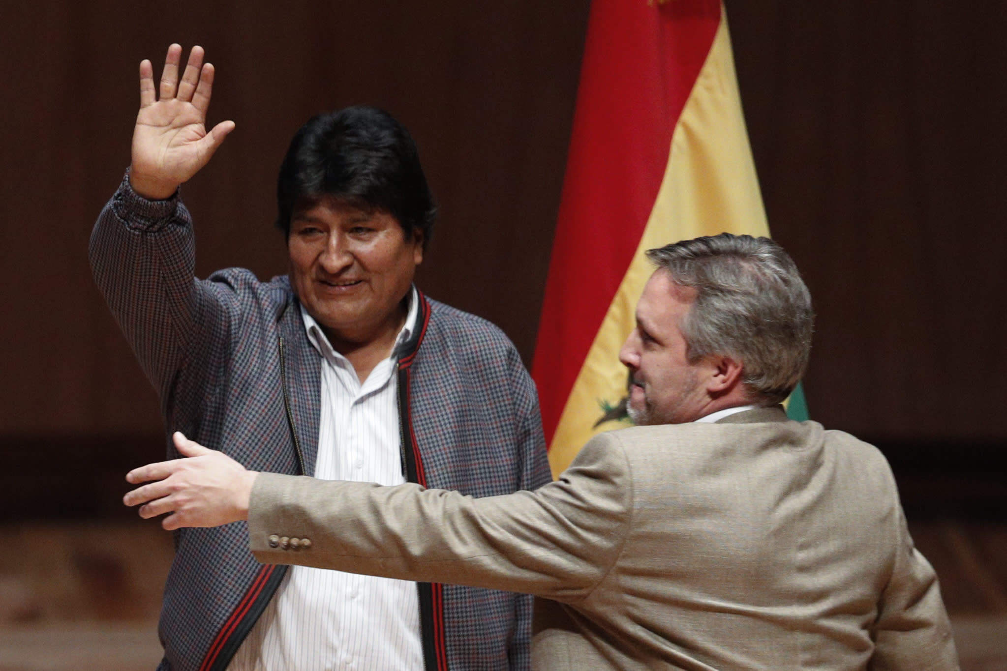Bolivia's former President Evo Morales waves as he arrives for a dialog with students and indigenous communities, at Ollin Yoliztli Cultural Center in Mexico City, Tuesday, Nov. 26, 2019. Bolivia is struggling to stabilize after weeks of anti-government protests and violence in which at least 30 people have been killed. Former president Evo Morales resigned on Nov. 10 after an election that the opposition said was rigged. (AP Photo/Rebecca Blackwell)