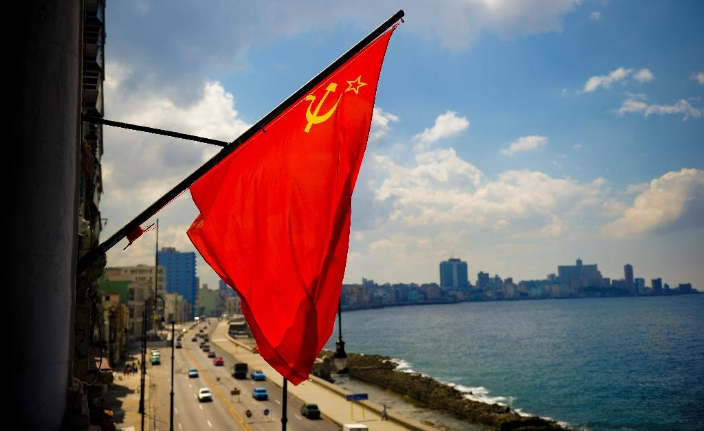 Almost 30 years after the Soviet Union was dissolved its flag still flies over the sea front in Havana (AFP Photo/Yamil LAGE)