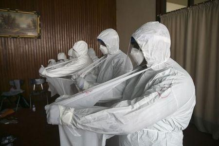 Sierra Leonean doctors practise wearing protective clothing in the Ebola Training Academy in Freetown