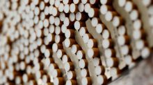 BAT cuts profit view in first sign of COVID hit to Big Tobacco