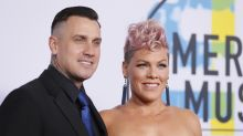 Pink's husband Carey Hart wears mask and gloves for cross-country flight amid coronavirus outbreak