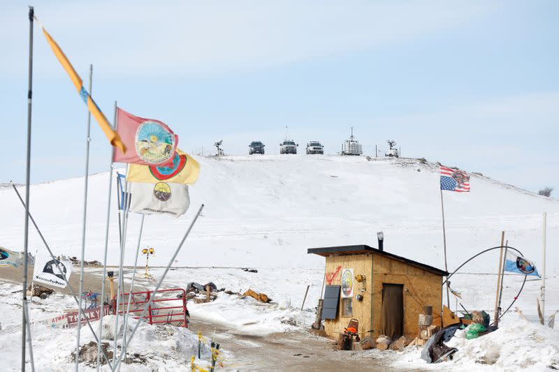 FILE PHOTO: Police vehicles idle on the outskirts of the opposition camp against the Dakota Access oil pipeline near Cannon Ball