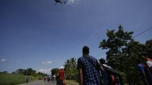 The Latest: Mexico's AMLO eyes development to fix migration