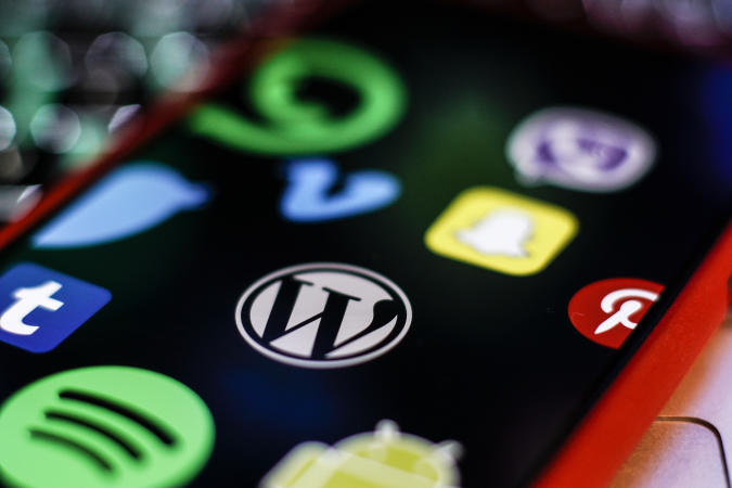 A Wordpress logo is seen on an iPhone screen in this photo illustration in Warsaw, Poland on March 5, 2019. (Photo by Jaap Arriens/NurPhoto via Getty Images)
