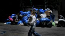 Athens rubbish piles up as Greeks protest contracts