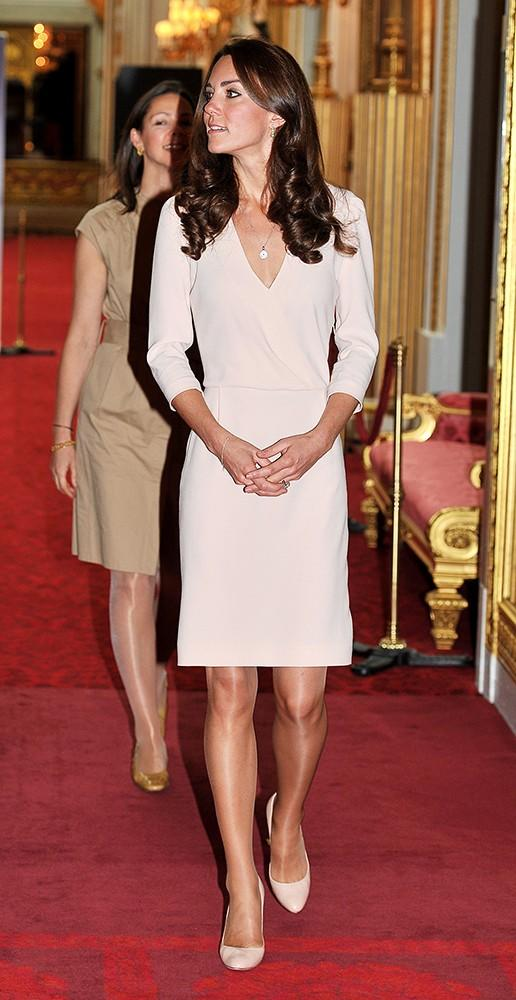 Kate and Wills are back in the U.K., the Duchess wearing a beige v-neck dress for the opening of the state rooms in Buckingham Palace.