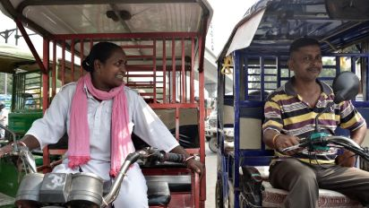 In Photos: Following Around Delhi's First Female E-Rickshaw Driver