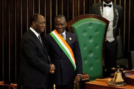Ivory Coast's President Alassane Ouattara (L) shakes hands with Soro Guillaume, president of Ivory Coast's parliament after his speach at the Ivorian parliament in Abidjan October 5, 2016. REUTERS/Luc Gnago