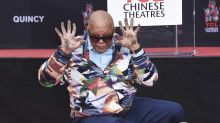 Quincy Jones dips hands and feet in cement outside Hollywood's Chinese Theatre