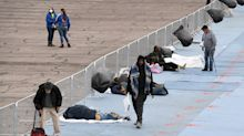 Vegas invited homeless to parking lot after virus closed shelter