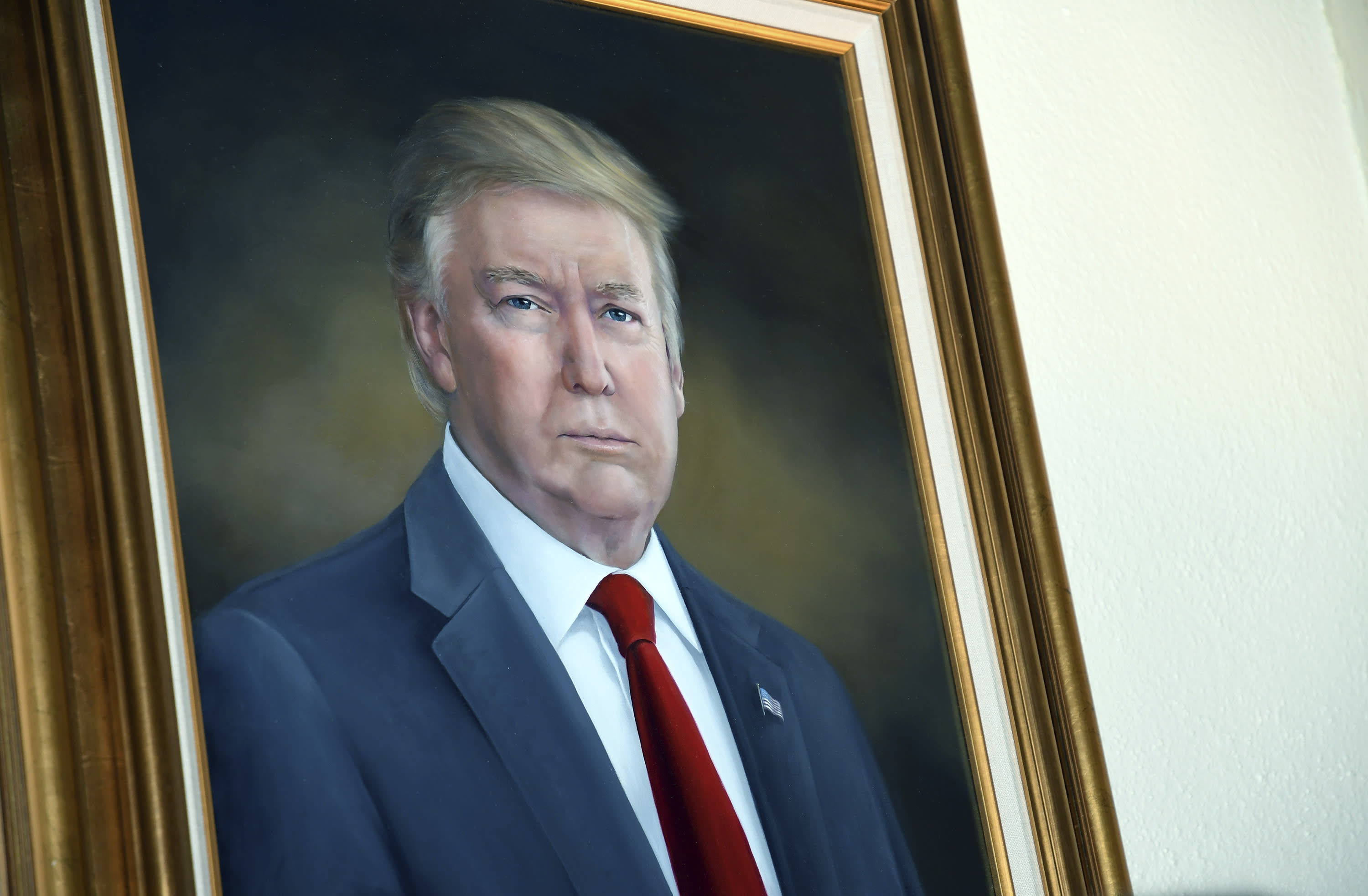President Donald Trump's portrait hangs in the Colorado Capitol after an unveiling ceremony Thursday, Aug. 1, 2019, in Denver. Colorado Republicans raised more than $10,000 through a GoFundMe account to commission the portrait, which was painted by Sarah Boardman, an artist who also produced the Capitol's portrait of President Barack Obama. (AP Photo/Thomas Peipert)