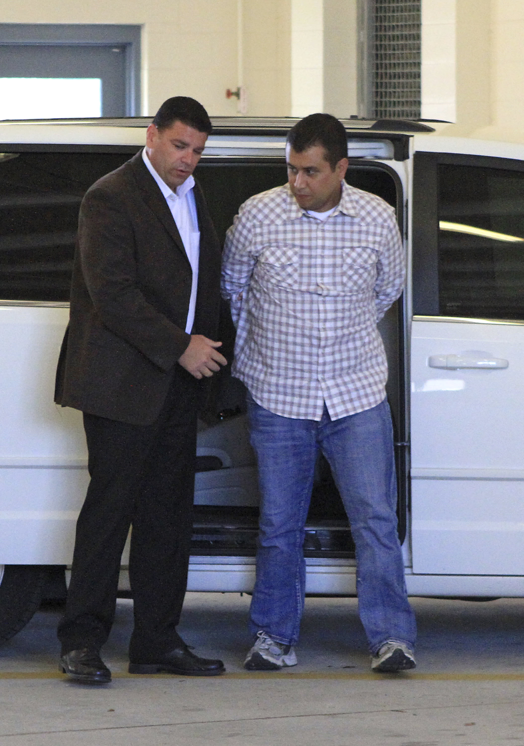 defense george zimmerman in police custody after his bond was revoked george zimmerman right returns to the john e