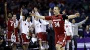 Badger dislocates shoulder, keeps shooting