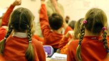Primary school children lose marks in Sats tests for misshapen commas