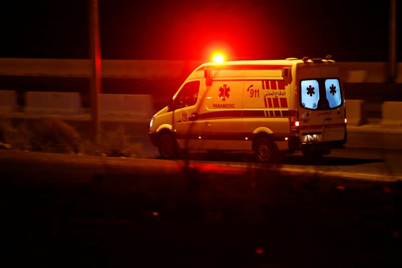 An ambulance heads towards the city of Zarqa at the highway between Amman and Zarqa