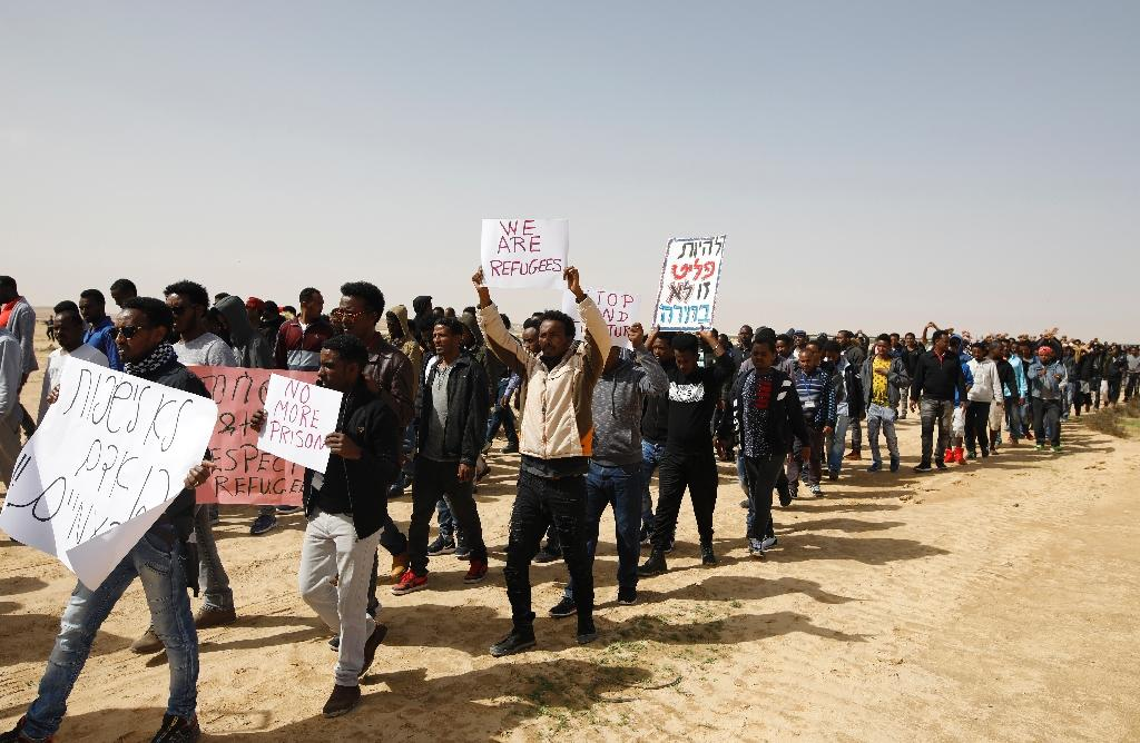 African migrants march from Holot detention centre to the Saharonim Prison, an Israeli detention facility for African asylum seekers, on February 22, 2018, to protest at Israel's policy of prison or deportation for migrants